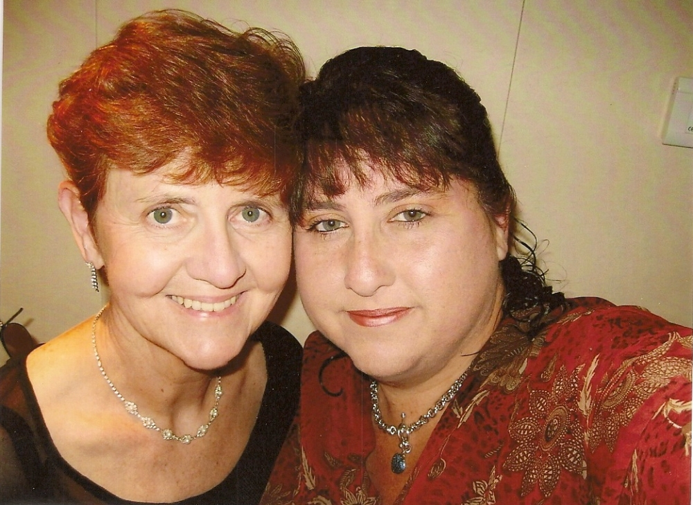 me and mom. Before I lost 180 pounds yes that is me.